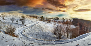 Countryside road at sunset, winter Stock Photo