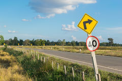 Countryside road with the traffic sign Stock Images