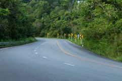 Countryside road with trees on both sides. Countrye road with trees on both es,Curve of the road to mountain stock photography