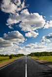 Countryside road under clouds Royalty Free Stock Photo