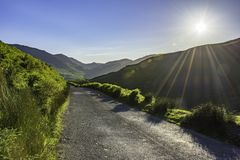 Stunning landscape of Lake District National Park,Cumbria,Uk. Countryside road with view on mountain valley in Lake District National Park,Cumbria,North West Stock Photography