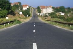 Countryside road. With village in background Stock Images