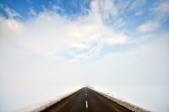 Countryside road through winter field Royalty Free Stock Photography