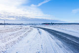 Countryside road through winter field Royalty Free Stock Images