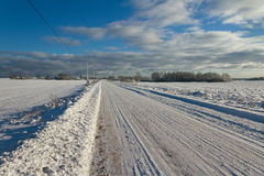 Countryside road in a winter. Stock Photo