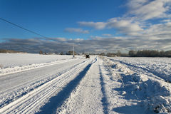 Countryside road in a winter. Stock Photos