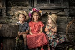 Countryside rustic lifestyle children sitting together old countryside house symbolizing kids friendship and happy carefree rusti stock photography