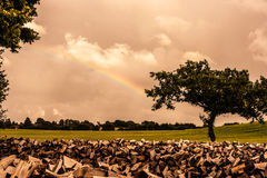 Countryside scenery. With a rainbow and cloudy weather Stock Photo