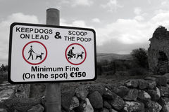 Countryside scoop the poop sign. Warning sign for all dog owners to scoop the poop in the country Stock Photo