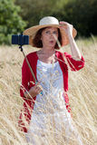 Countryside selfy classes for mature woman's vacation Stock Photo