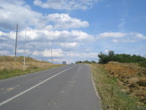 Countryside sloping road, with construction works on sides Stock Images
