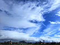 Countryside summer with clear skies. Blue white clouds in country stock photography