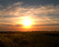 Countryside Sunset. Beautiful sunset over a windfarm and crops on the Norfolk landscape Royalty Free Stock Photo