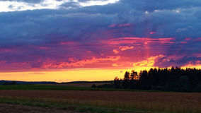 Countryside sunset sky while driving Royalty Free Stock Photo
