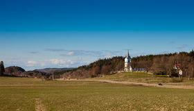 Countryside in sweden. An idyllic view of the swedish countryside. An old church and some houses, a road and farmland Stock Images