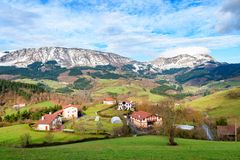Rural tourism at Basque Country fields, Spain. Countryside town located at Basque Country in Aramaio valley, Spain Royalty Free Stock Photo