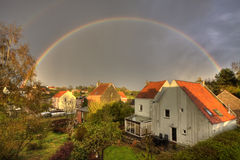 A countryside town with rainbow Stock Photos