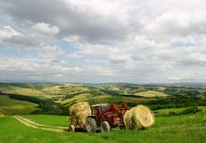 Countryside of Tuscany. Farmer on his tractor on tuscany hill Royalty Free Stock Image