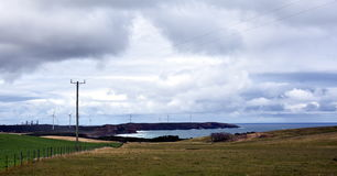 Countryside, view of huge wind turbines windmill Stock Images