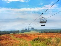 A colorful countryside with cableway at Kubinska Hola mountain. A countryside view showing colorful meadows with road and cableway leading down from Kubinska royalty free stock photography