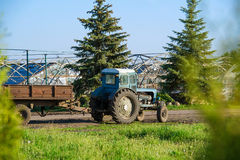 Countryside view with tractor Stock Photography