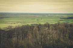 Countryside view with windmills Stock Images
