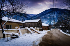Countryside Village On Winter Snow Stock Photo