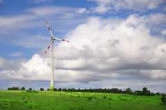 Countryside wind turbine with clouds Royalty Free Stock Photos