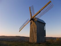 Countryside windmill. Windmill in a countryside on sunset, sky background Royalty Free Stock Photography