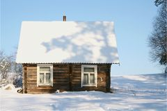 Countryside winter. A small country house in clear winter day Stock Image