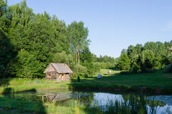 Countryside with wooden bathhouse and green nature Stock Photo