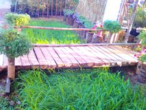 Countryside. Wooden brige watch garden Royalty Free Stock Photo