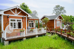 Countryside wooden cabins in sunny summer Royalty Free Stock Photography