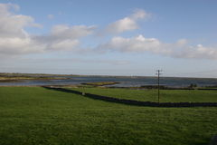 County Clare Coastline. Coastal view across rolling fields in County Clare, Ireland - Jan. 2005 Royalty Free Stock Images