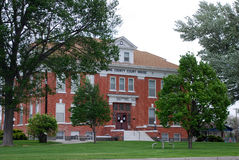 County Courthouse. Red brick county courthouse with trees Stock Photography