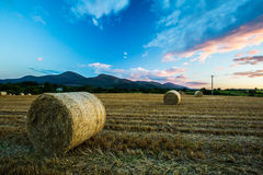 County Down sunset and Mountains of Mourne. A sunset over a field with bales of hay and the Mountains of Mourne in the background in County Down in Northern royalty free stock photography