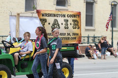 County Fair display in a parade with kids in small town America. County Fair display in a parade with kids  in a summer parade in small town America Stock Images