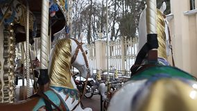 County fair fairground merry-go-round at daytime in winter stock video