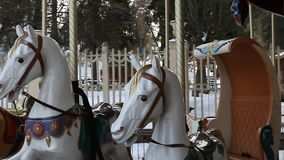 County fair fairground merry-go-round at daytime in winter stock video footage