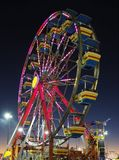 The County Fair Ferris Wheel at Night. The County Fair Ferris Wheel as the Sun Sets Royalty Free Stock Images