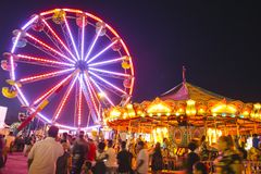 County Fair at night with ferris wheel Stock Image