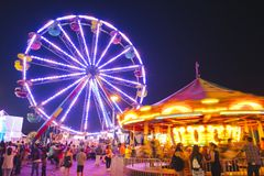 County Fair at night with ferris wheel Royalty Free Stock Image