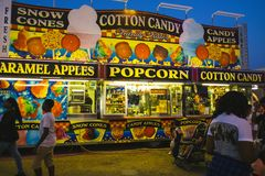 County Fair at night. With ferris wheel,cotton candy, caramel apples, popcorn Royalty Free Stock Photography