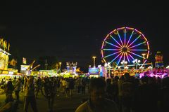 County Fair at night Ferris Wheel on the Midway Royalty Free Stock Photography