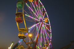 County Fair at night Ferris Wheel on the Midway Royalty Free Stock Image