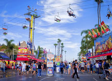 County Fair, San Diego California. People walk down the main street of the San Diego County Fair, formerly the Del Mar Fair, with colorful food vendors lining Stock Photos
