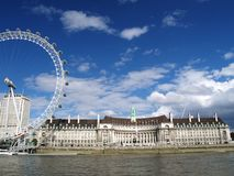County Hall and London Eye. View from a boat on the Thames of County Hall and the London Millenium Eye Stock Image