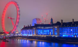 The County Hall and London Eye big wheel at night, UK. Stock Photo