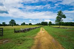 County Lane Lined by Stack Rail Fencing. County lane located in Appomattox County lined by two stack rail fencing Stock Photo