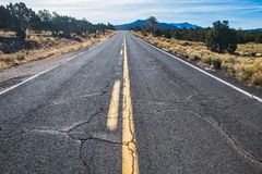 County road in Arizona, USA. Picture of an empty county road in the desert in Arizona, USA royalty free stock photos